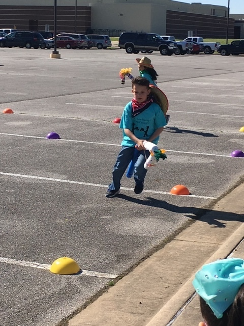 Students participating in Stick Horse Rodeo Games