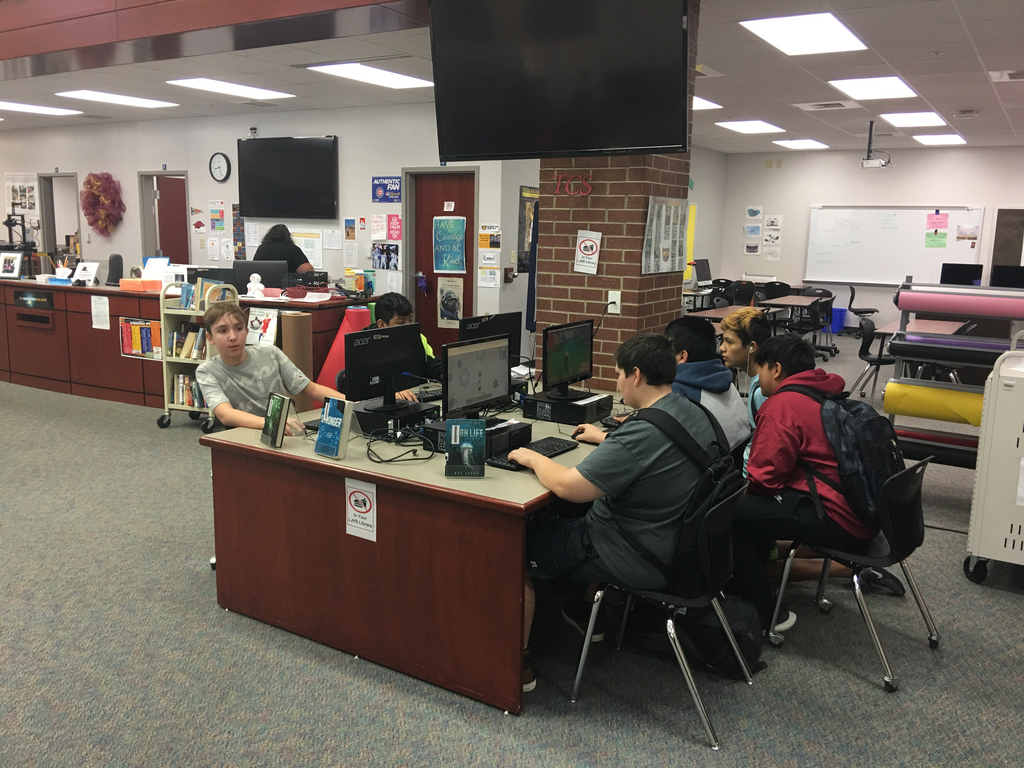 Students working in library.