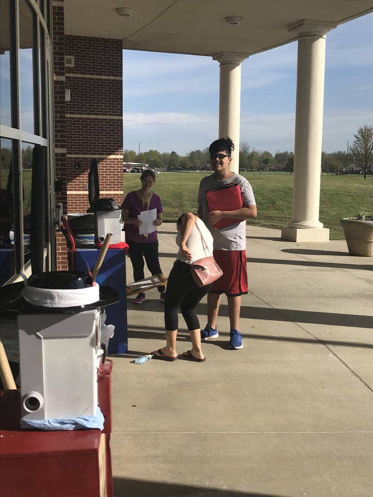 Students picking up packets at George Junior High