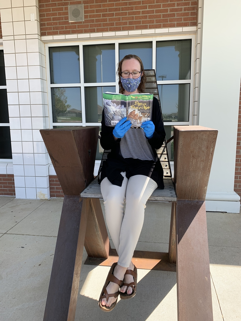 Mrs. Johnson is enjoying a book from the free library