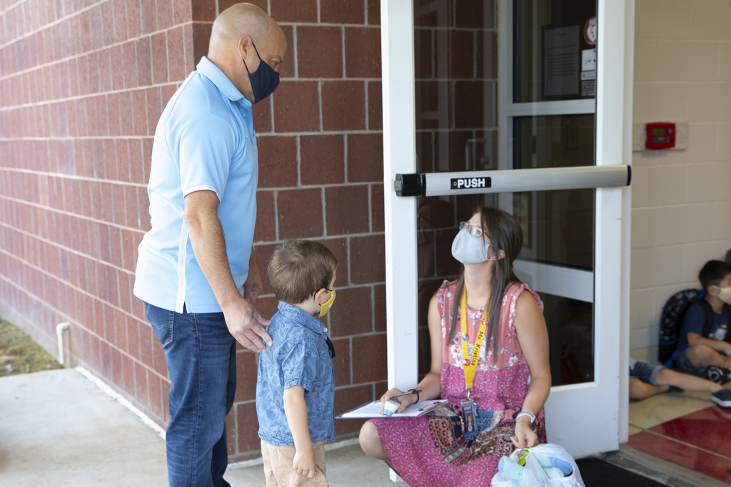 A student is screened before entering Young Elementary